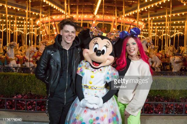 Musicians Halsey and Yungblud pose with Minnie Mouse at Disneyland Park on February 22 2019 in Anaheim California