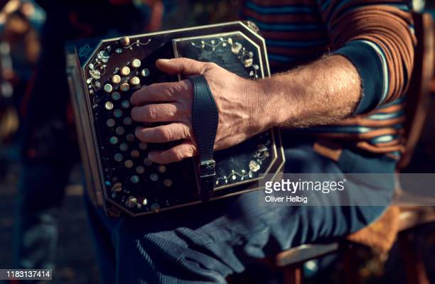 musicians hand plays on antique accordion - folk music stock pictures, royalty-free photos & images