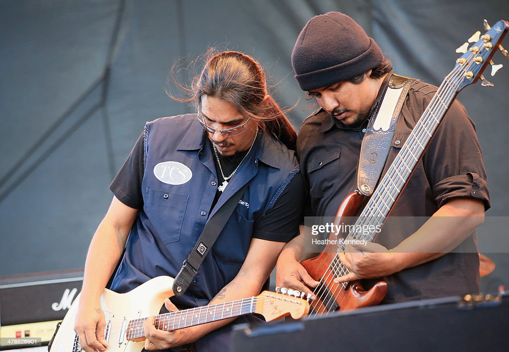 Musicians Henry Garza and Jojo Garza of Los Lonely Boys perform onstage at the USPS Hendrix Stamp Event + Los Lonely Boys during the 2014 SXSW Music, Film + Interactive at Butler Park on March 13, 2014 in Austin, Texas.