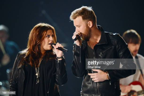 Musicians Hillary Scott and Charles Kelley of Lady Antebellum perform onstage during Tim McGraw's Superstar Summer Night presented by the Academy of...