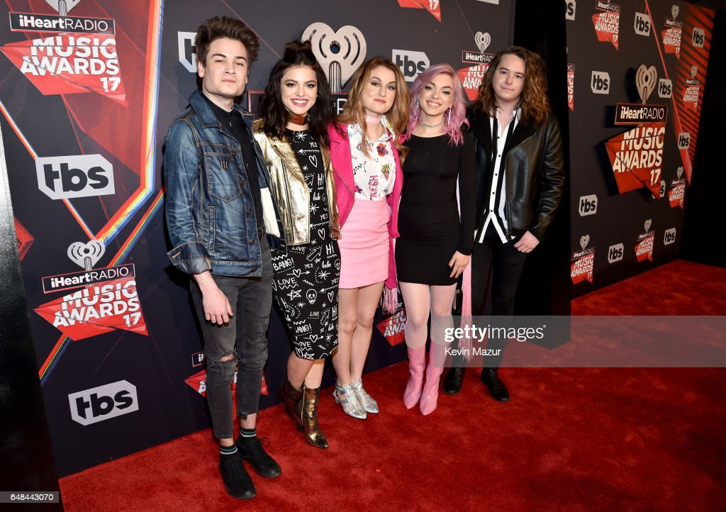 Musicians Iain Shipp, Nia Lovelis, Miranda Miller, Rena Lovelis and Casey Moreta of the group Hey Violet attend the 2017 iHeartRadio Music Awards which broadcast live on Turner's TBS, TNT, and truTV at The Forum on March 5, 2017 in Inglewood, California.