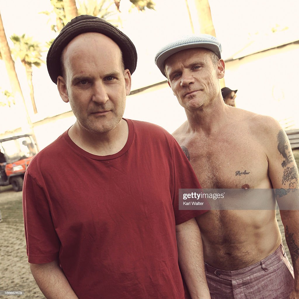 Musicians Ian MacKaye and Flea backstage during day 3 of the 2013 Coachella Valley Music & Arts Festival at the Empire Polo Club on April 14, 2013 in Indio, California.