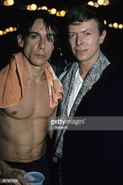 Musicians Iggy Pop and David Bowie pose backstage after Pop's concert at the Ritz, New York, New York, 1986.