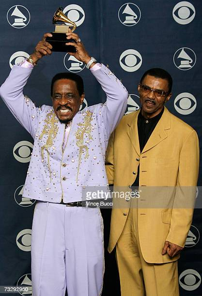 Musicians Ike Turner and Ike Turner Jr pose with his Grammy for Best Traditional Blues Album for 'Risin' With The Blues' in the press room at the...