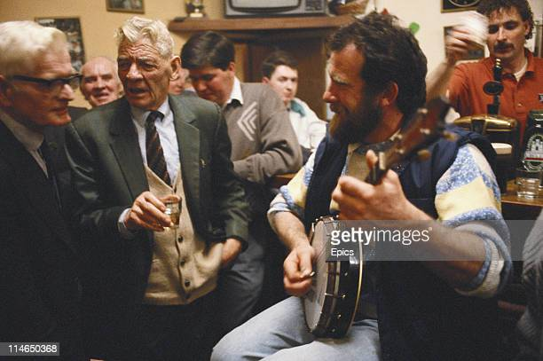 Musicians in a pub play and entertain with traditional Irish music near Lough Conn County Mayo Ireland circa 1992