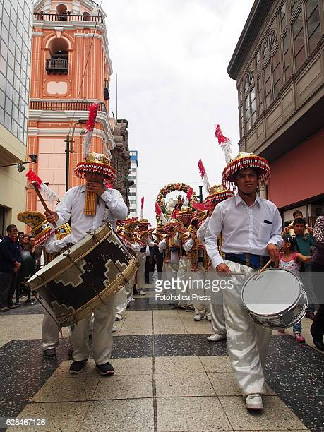 Musicians in an Andean folkloric parade and 'morenada' a traditional dance celebrating the day of Our Lady of the Rosary in La Merced Church in Lima...