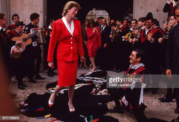Musicians in Salamanca Spain drape their cloaks in front of Princess Diana as a mark of respect on April 23 1987 She Is wearing a dress designed by...