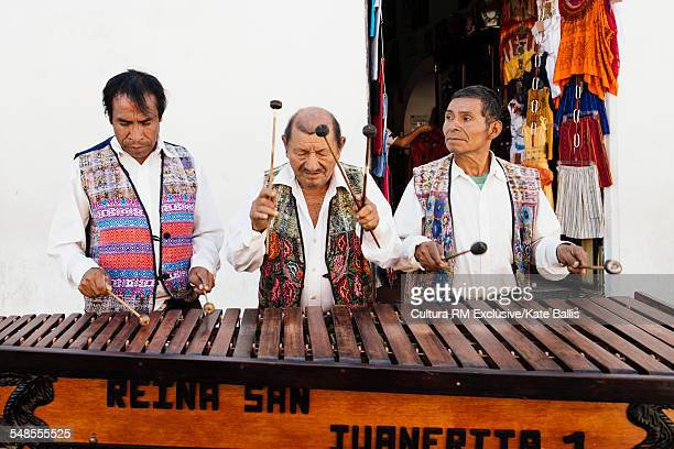 Musicians in traditional clothes, Antigua, Guatemala