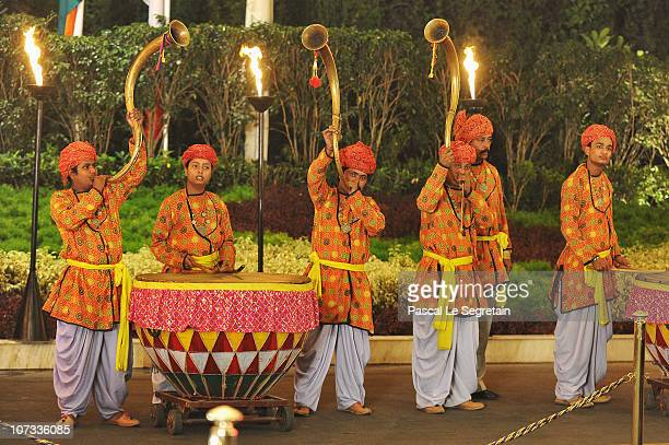 Musicians in traditional dress look on as French first lady Carla BruniSarkozy and French President Nicolas Sarkozy arrive at the Taj Mahal Palace...