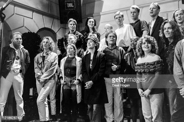 Musicians including Kylie Minogue Wet Wet Wet Cliff Richard Lisa Stansfield Big Fun Bananarama Glen Goldsmith and Sonia during the recording of the...