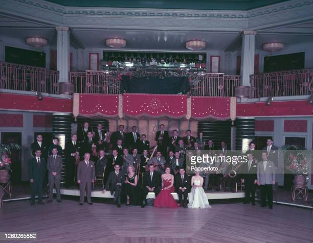 Musicians, instrumentalists and singers, all members of Ted Heath's big band, posed together at a dance hall in England in December 1954. Musicians...