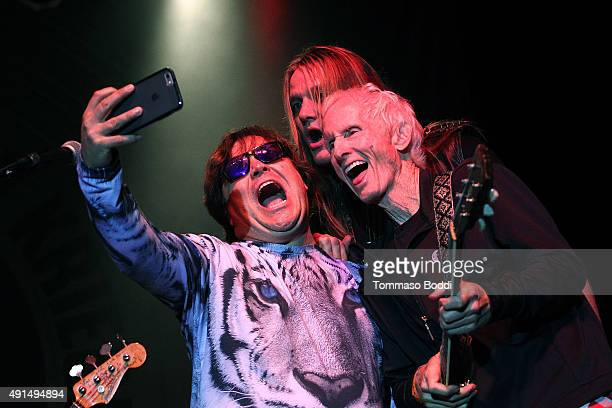Musicians Jack Black Sebastian Bach and Robby Krieger take a selfie on stage during the Medlock Krieger Celebrity Golf Invitational 2015 All Star...