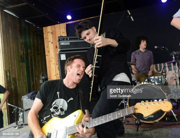 Musicians Jack Hines Cole Alexander and Joe Bradley of The Black Lips perform onstage during the Austin Chronicle SXSW day party at Barracuda on...