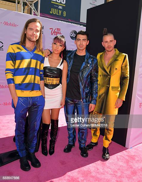Musicians Jack Lawless JinJoo Lee Joe Jonas and Cole Whittle of DNCE attend the 2016 Billboard Music Awards at TMobile Arena on May 22 2016 in Las...