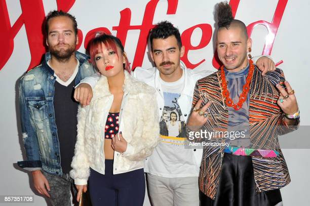 Musicians Jack Lawless JinJoo Lee Joe Jonas and Cole Whittle of DNCE attend the grand opening of Westfield Century City at Westfield Century City on...