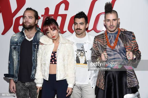 Musicians Jack Lawless JinJoo Lee Joe Jonas and Cole Whittle of the band DNCE arrives at the grand opening of Westfield Century City at Westfield...