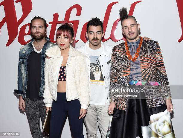 Musicians Jack Lawless JinJoo Lee Joe Jonas and Cole Whittle of the band DNCE arrive at the grand opening of Westfield Century City at Westfield...