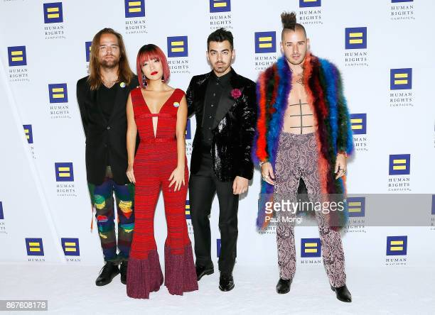 Musicians Jack Lawless JinJoo Lee Joe Jonas and Cole Whittle of the band DNCE attend the 21st Annual HRC National Dinner at the Washington Convention...
