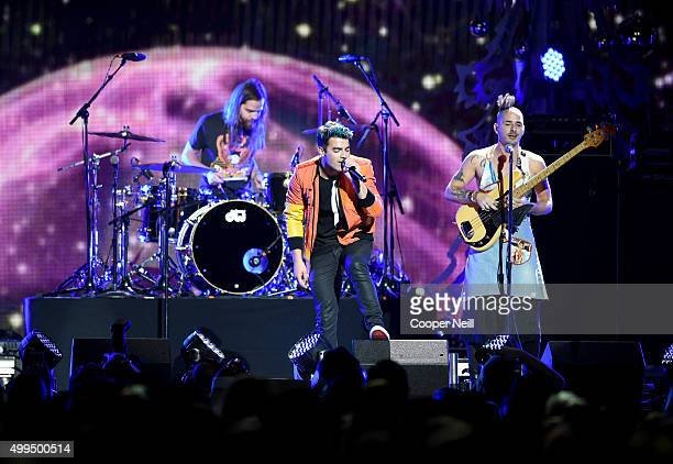 Musicians Jack Lawless, Joe Jonas, and Cole Whittle of DNCE perform onstage during 106.1 KISS FM's Jingle Ball 2015 presented by Capital One at...