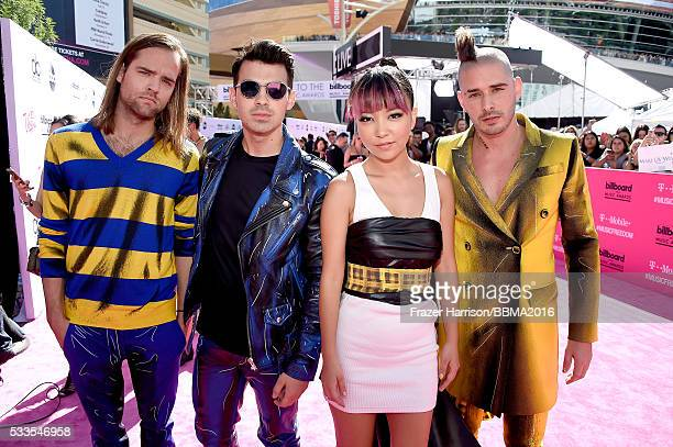 Musicians Jack Lawless Joe Jonas JinJoo Lee and Cole Whittle of DNCE attend the 2016 Billboard Music Awards at TMobile Arena on May 22 2016 in Las...