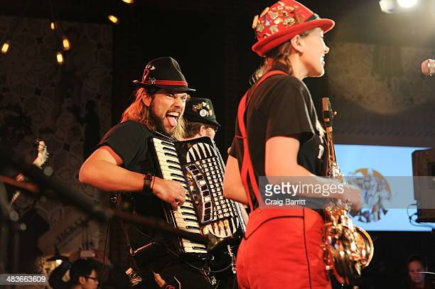 Musicians Jake Kouwe and Emily Burke of The Chardon Polka Band perform at the REELZ Channel upfront presentation at Hudson Hotel on April 9 2014 in...