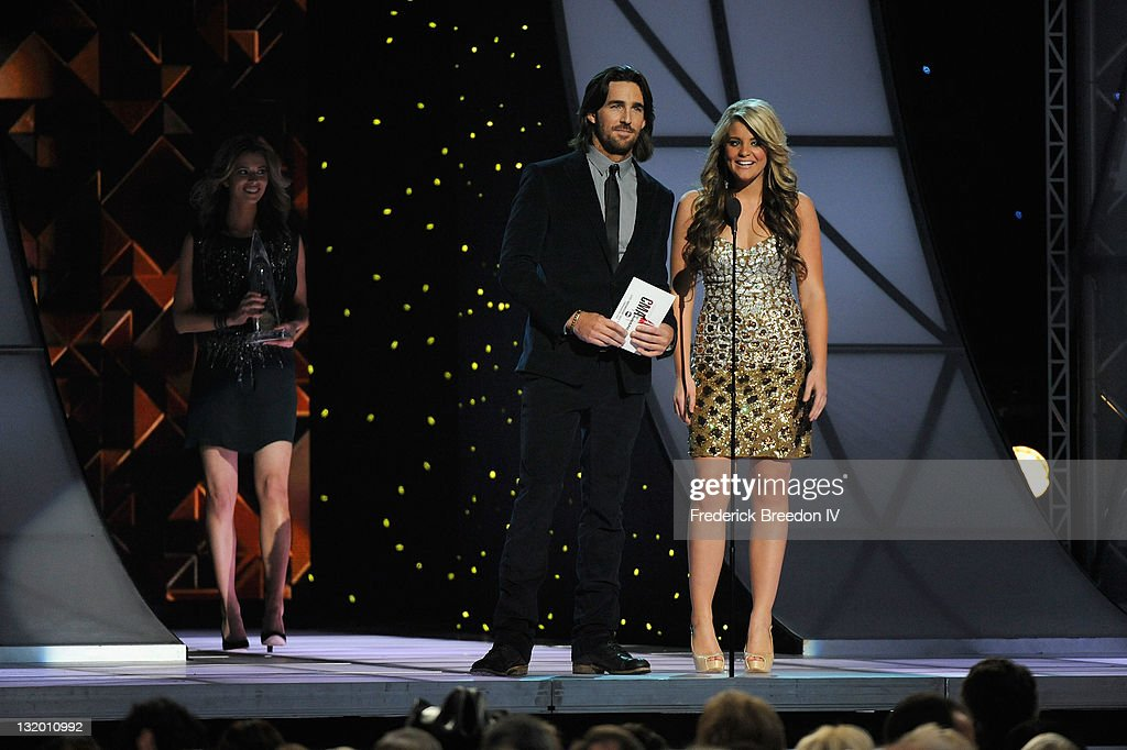 Musicians Jake Owen and Lauren Alaina during the 45th annual CMA Awards at the Bridgestone Arena on November 9, 2011 in Nashville, Tennessee.