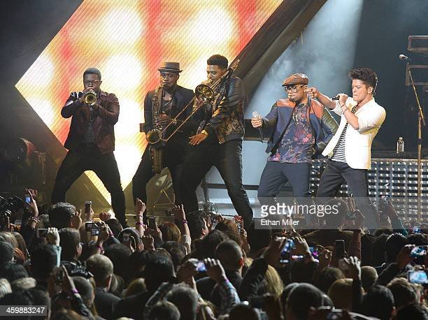 Musicians James King Dwayne Dugger and Kameron Whalum singer/songwriter Philip Lawrence and recording artist Bruno Mars perform during a New Year's...