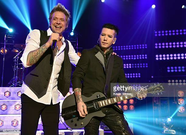 Musicians James Michael and DJ Ashba of Sixx AM perform for iHeartRadio Live at The iHeartRadio Theater Los Angeles on October 7 2014 in Burbank...
