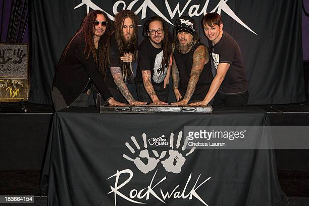 Musicians James 'Munky' Shaffer Brian 'Head' Welch Jonathan Davis Reginald 'Fieldy' Arvizu and Ray Luzier of KoRn are inducted into Guitar Center's...
