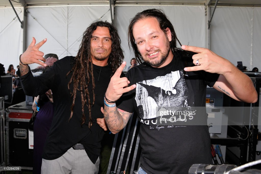 Musicians James Shaffer (L) and Jonathan Davis of the band Korn pose backstage during Day 1 of the Coachella Valley Music & Arts Festival 2011 held at the Empire Polo Club on April 15, 2011 in Indio, California.