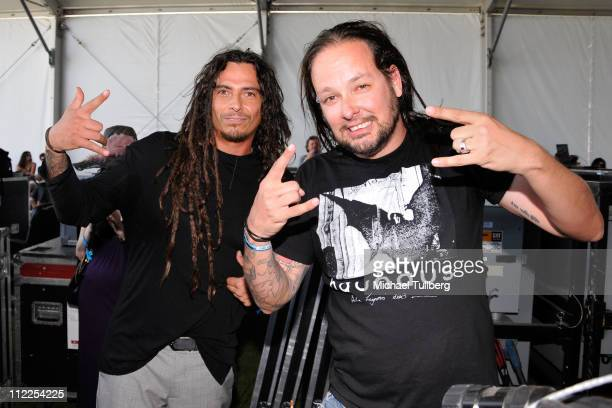Musicians James Shaffer and Jonathan Davis of the band Korn pose backstage during Day 1 of the Coachella Valley Music Arts Festival 2011 held at the...