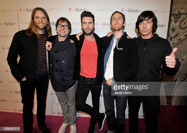 Musicians James Valentine Mickey Madden Adam Levine Jesse Carmichael and Matt Flynn of Maroon 5 arrive on the TMobile magenta carpet for the launch...