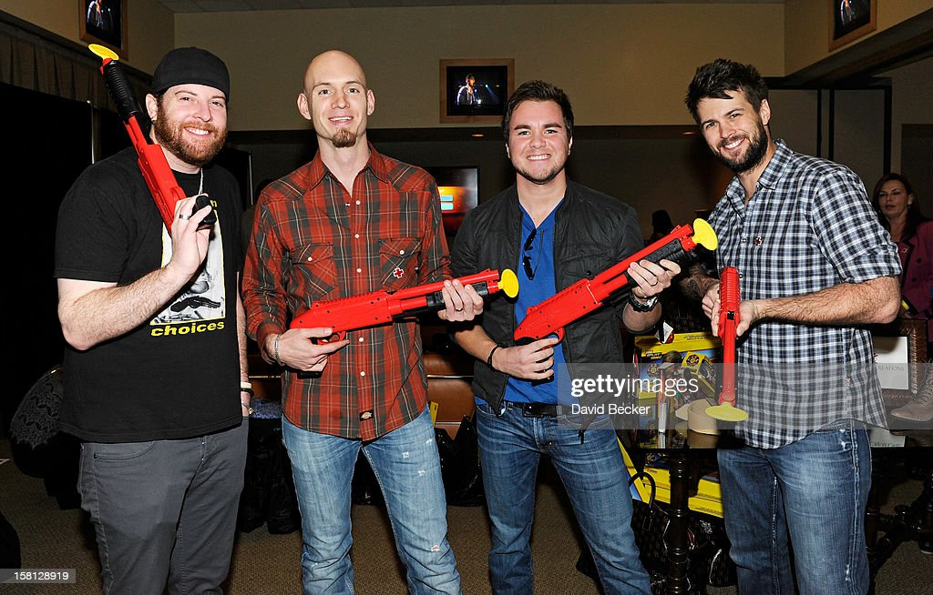 Musicians James Young, Jon Jones, Mike Eli and Chris Thompson of the Eli Young Band attend the Backstage Creations Celebrity Retreat at 2012 American Country Awards at the Mandalay Bay Events Center on December 10, 2012 in Las Vegas, Nevada.