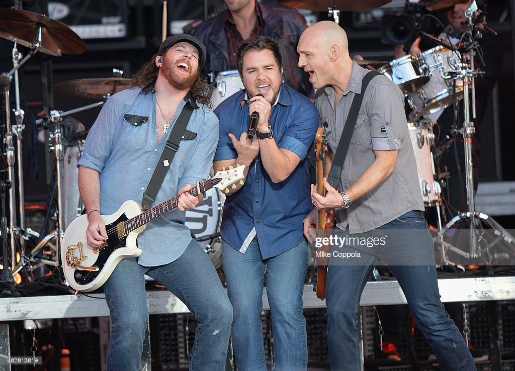 Musicians James Young, Mike Eli and Jon Jones of Eli Young Band perform onstage during the AT&T Block Party at NCAA March Madness Music Festival - Day 1 at Reunion Park on April 4, 2014 in Dallas, Texas.