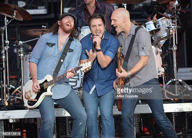 Musicians James Young Mike Eli and Jon Jones of Eli Young Band perform onstage during the ATT Block Party at NCAA March Madness Music Festival Day 1...