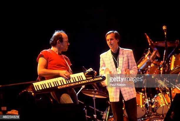 Musicians Jan Hammer and Andy Fairweather-Low perform on stage during an ARMS Charity Concert, Dallas, Texas, November 27, 1983.