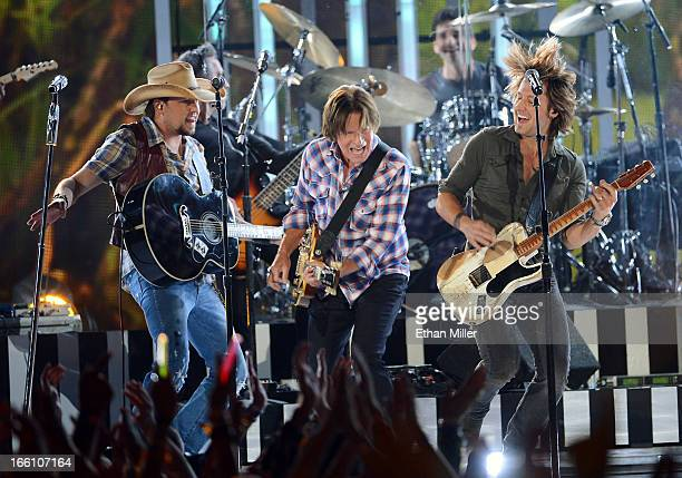 Musicians Jason Aldean John Fogerty and Keith Urban perform onstage during Tim McGraw's Superstar Summer Night presented by the Academy of Country...