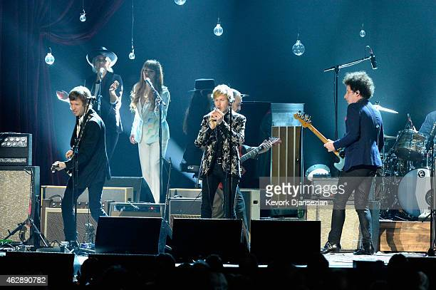 Musicians Jason Falkner Beck and Justin MeldalJohnsen perform onstage at the 25th anniversary MusiCares 2015 Person Of The Year Gala honoring Bob...