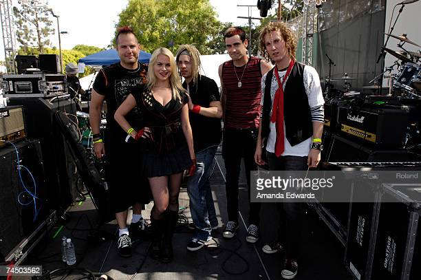 Musicians Jason Graham Dhana Taprogge Gregg Allen Brian Hendrix and Matt Emmer of Taxi Doll pose backstage at the LA Pride Festival Main Stage on...