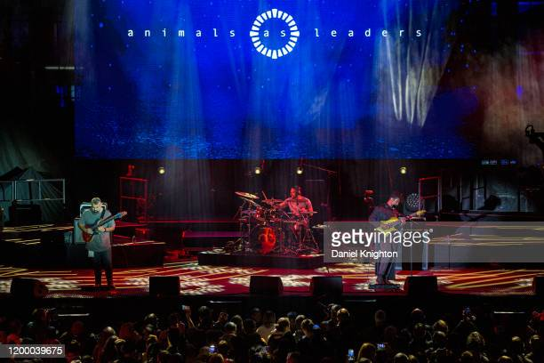 Musicians Javier Reyes, Matt Garstka, and Tosin Abasi of Animals as Leaders perform on stage at The NAMM Show 2020 Day 1 at Anaheim Convention Center...