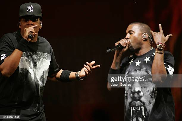 """Musicians Jay-Z and Kanye West perform during the """"Watch The Throne"""" tour at Sprint Center on November 29, 2011 in Kansas City, Missouri."""