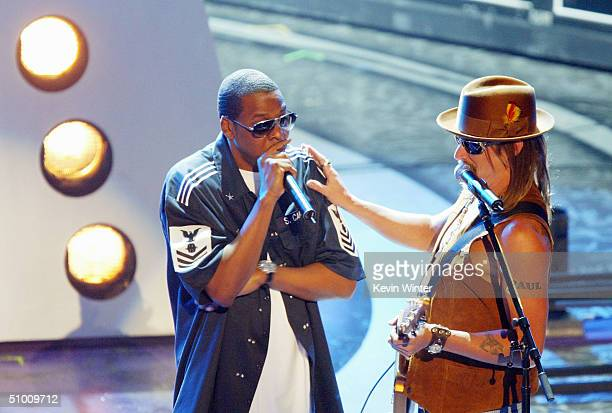 Musicians JayZ and Kid Rock perform on stage at the 2004 Black Entertainment Awards held at the Kodak Theatre on June 29 2004 in Hollywood California