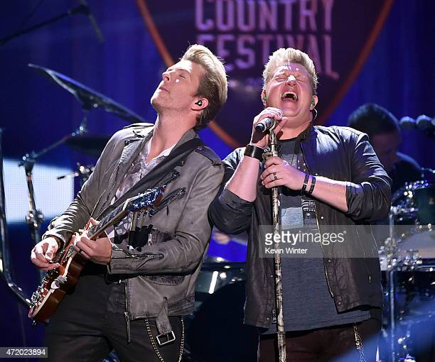 Musicians JD Rooney and Gary LeVox of Rascal Flatts perform onstage during the 2015 iHeartRadio Country Festival at The Frank Erwin Center on May 2...