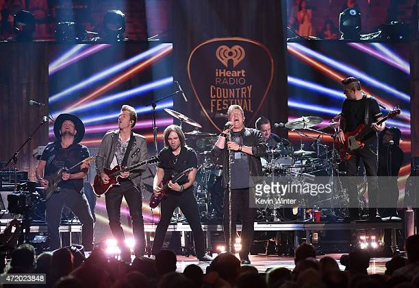 Musicians JD Rooney Gary LeVox and Jay DeMarcus of Rascal Flatts perform onstage during the 2015 iHeartRadio Country Festival at The Frank Erwin...