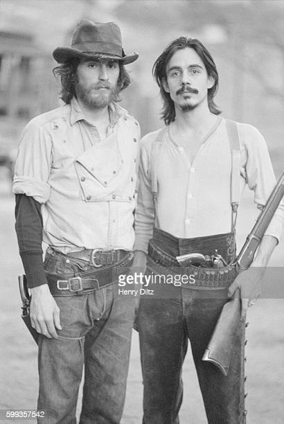 Musicians JD Souther and Jackson Browne are dressed as outlaws during a photo shoot for the Eagles' Desperado album