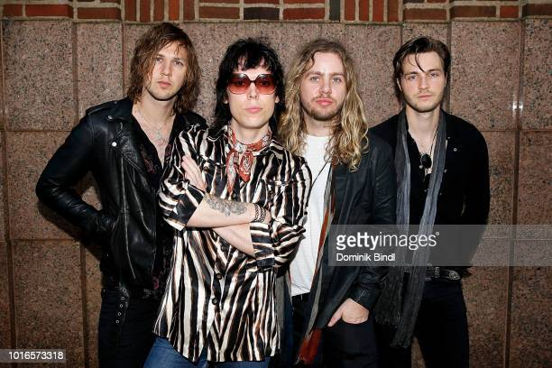 Musicians Jed Elliott Luke Spiller Adam Slack and Gethin Davies of the music group The Struts posing on the sidewalk after their visit at Z100 Studio...