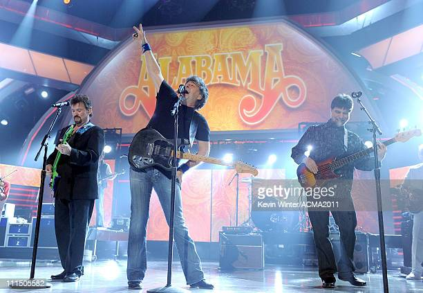 Musicians Jeff Cook Randy Owen and Teddy Gentry from the band Alabama perform onstage during the 46th Annual Academy of Country Music Awards held at...