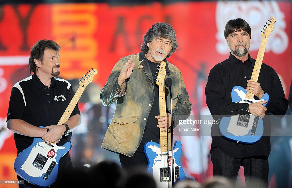 Musicians Jeff Cook, Randy Owen and Teddy Gentry of the band Alabama accept the Greatest Hits Award onstage at the American Country Awards 2011 at the MGM Grand Garden Arena on December 5, 2011 in Las Vegas, Nevada.