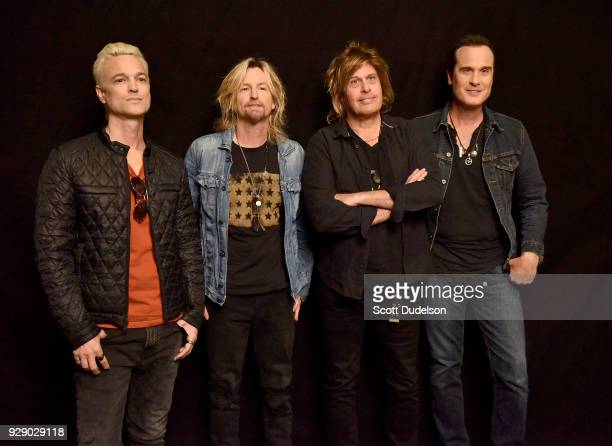 Musicians Jeff Gutt Eric Kretz Dean DeLeo and Robert DeLeo of Stone Temple Pilots attend a live taping of ATT AUDIENCE Network Music Series at Red...