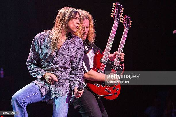 Musicians Jeff Keith and Frank Hannon perform on stage with Tesla on September 19 2014 in El Cajon California